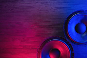 Self adhesive Wall Murals Music store A car audio loudspeaker on the table in the neon lights.