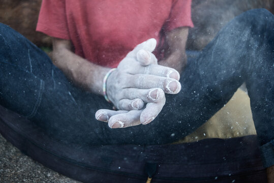 rock climber hands coated in chalk powder