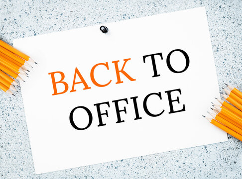 Back to Office text on grey notice board with yellow pencils. Back to normal. Reopening business after lockdown or pandemic. Returning after leave or break. Measures guidance or advice notice.