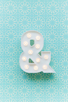Ampersand marquee light on a blue background
