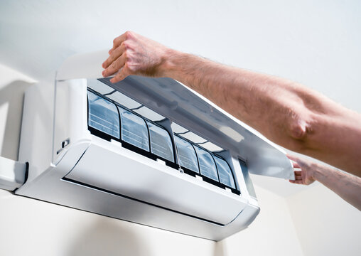Man lifting the air conditioner cover