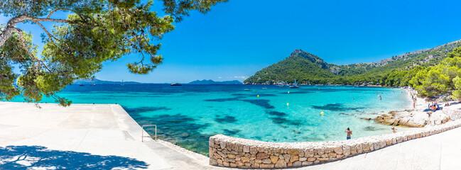 Platja de Formentor, Mallorca, Spain - July 20, 2020: People enjoying popular beach in summer,...