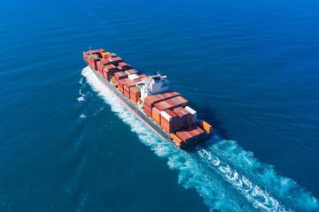 Fototapeta Zim Tarragona loaded Container ship cruising away from port, Aerial view.  obraz