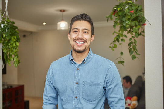 portrait of a hispanic young man with braces