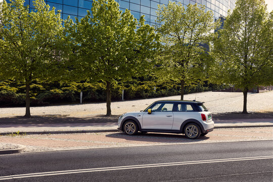 Katowice / Poland - 05.09.2020 : First fully electric Mini parked next to the building of bank. The Mini has a range of up to 230 km, 184 hp engine and accelerates from 0 to 100 km/h in 7.3 seconds.