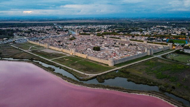 Aerial view of Aigues Mortes, a medieval city surrounded with salt marshes in Camargue, south of France - Fortified town center near the Mediterranean Sea