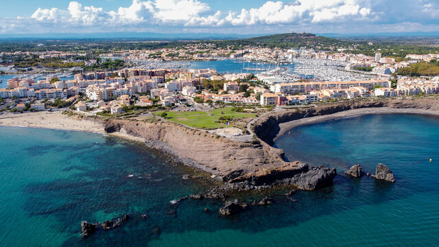Aerial view of the Cap d'Agde sea resort on the South of France along the Mediterranean Sea - Rocky cape from above