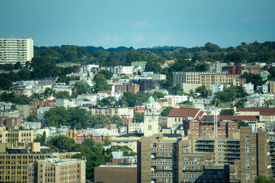 Yonkers, NY / United States - Oct. 6, 2020: a view of Yonker's skyline; apartments, businesses, city hall and churches.