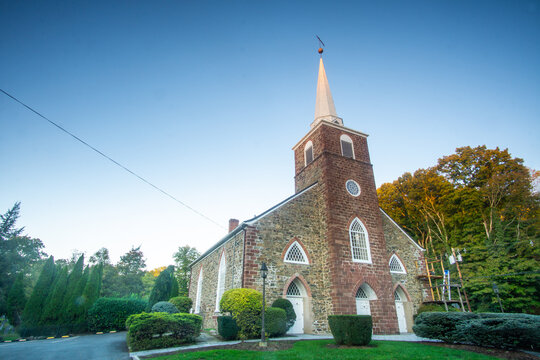 Upper Saddle River, NJ / United States - Oct. 2, 2020: a wide landscape view of the historic The Old Stone Church,, built in 1789.