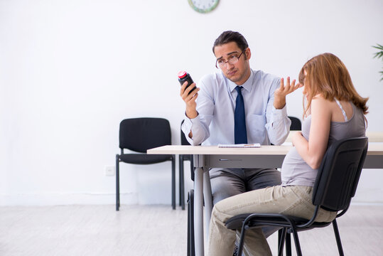Pregnant woman visiting male psychologist doctor