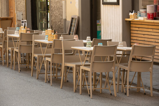 Tables and chairs set up outside a restaurant