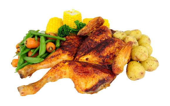 Roasted spatchcock chicken with piri piri seasoning and mixed vegetables isolated on a white background