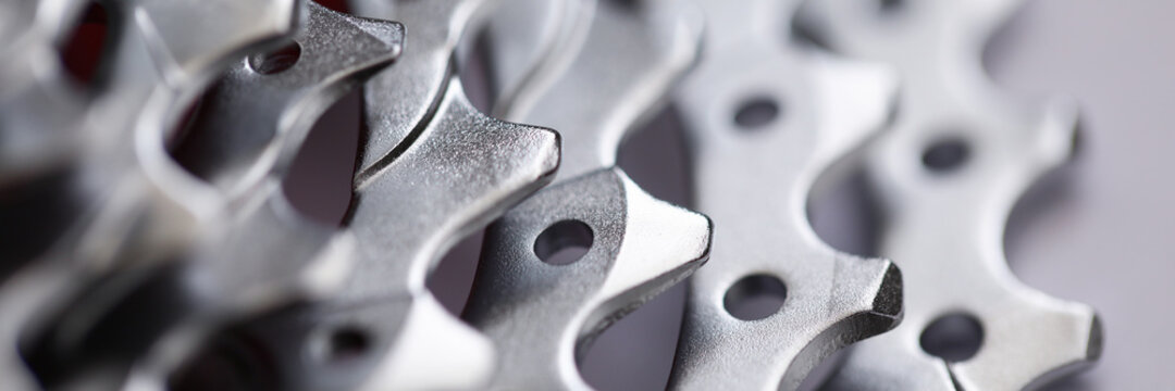 Close-up of bicycle roller chain that transfers power from pedals to drive. Macro shot of metal wheel detail for vehicle. Rear cassette in mountain bike. Transport component concept