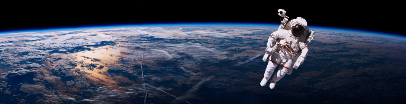 Astronaut walking in space with earth background. Elements of this image furnished by NASA