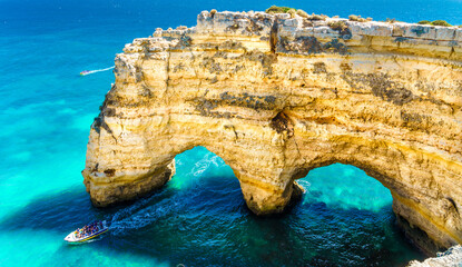 Wall Mural - Landscape with natural arch, near Praia da Marinha, one of the most famous place of Portugal, located on the Atlantic coast in Lagoa, Algarve.