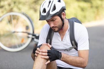 man cyclist fell fell off road bike while cycling