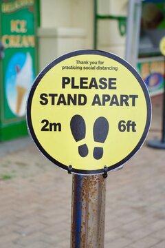 Covid 19 markings, please stand 2 meters or 6 feet apart