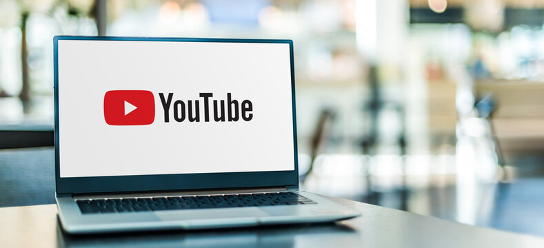 Laptop computer displaying logo of YouTube
