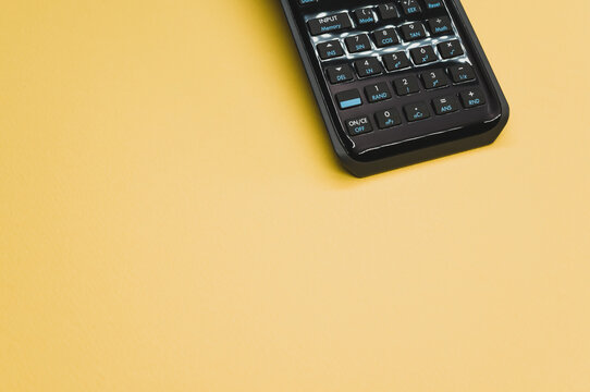 Scientific calculator on pastel yellow background with an empty space for a text