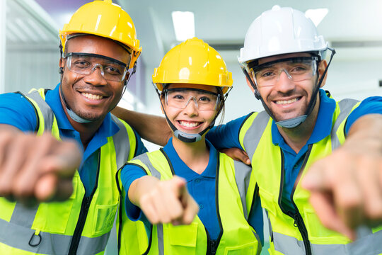 Close up portrait team of young multiethnic group male and female technician staff wearing a protective helmet. Happy teamwork laugh smile posing at camera smiling.