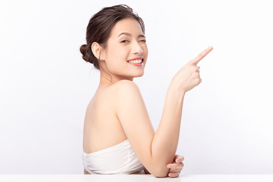 Young asian woman natural beauty makeup, Fashion model, Health wellness, Beautiful girl skin care and facial treatment. Isolated on beige background. With copy space for your text.