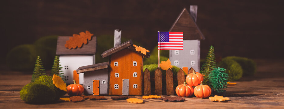 Miniature Thanksgiving little autumn cottages village in the forest, banner