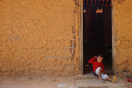 A child from the Guajajara indigenous ethnic group looks on in the indigenous village of Morro Branco