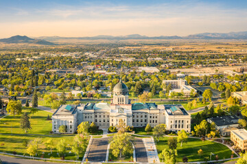 Drone view of the Montana State Capitol, in Helena, on a sunny afternoon with hazy sky caused by wildfires. The Montana State Capitol houses the Montana State Legislature.
