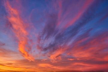 sunset sky with multicolor clouds. Dramatic twilight sky background