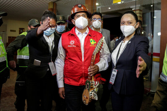 Candidate Feliciano Mamani of the Bolivian National Action (PAN-BOL) party holds a charango as he arrives for the 2020 Bolivian presidential campaign debate in La Paz, Bolivia
