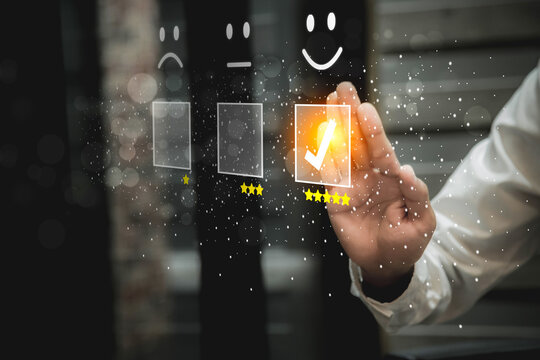 Businessman pressing smiley face emoticon on virtual touch screen. Customer service evaluation   Service rating, satisfaction  concept.