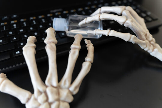 Skeleton Claw hands working on keyboard during Halloween