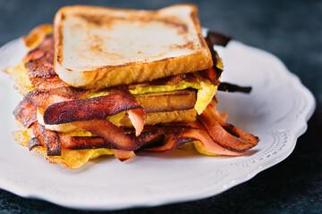 breakfast ham, bacon and egg sandwich