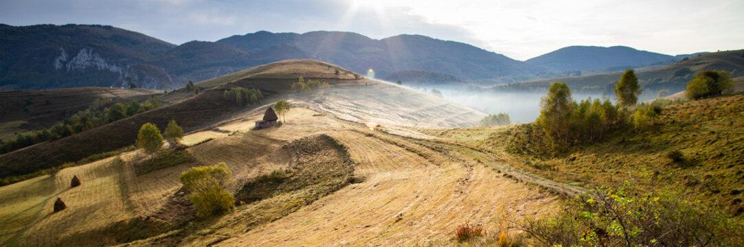 rural Romania beautiful foggy morning landscape in Apuseni mountains