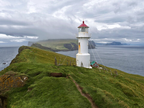 Panoramic view of Old lighthouse on the beautiful island Mykines, Faroe islands, Denmark