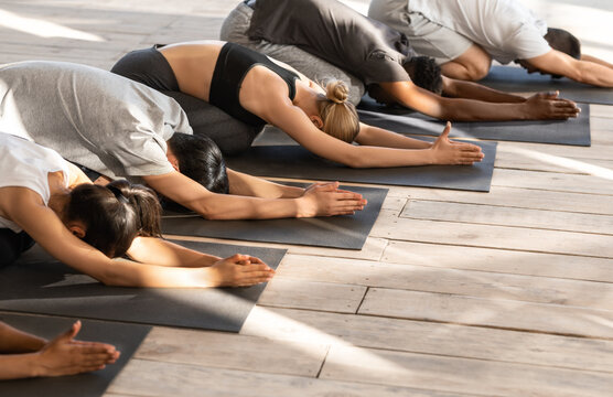 Top View Of Yoga Group Members Meditating Together In Child's Pose
