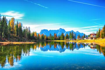 Stunning view of popular travel destination mountain lake Antorno in autumn