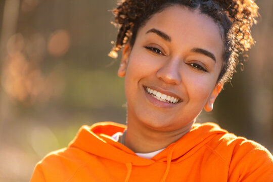 Mixed Race African American Girl Teenager Smiling Laughing in Evening Sunshine