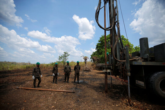 Members of the Brazilian Armed Forces  drill artesian wells at the indigenous village of Bacurizinho