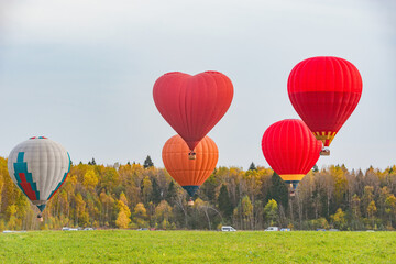 Morning flight of the hot air balloons above the countryside.