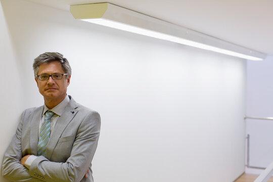 Portrait confident mature corporate businessman in suit