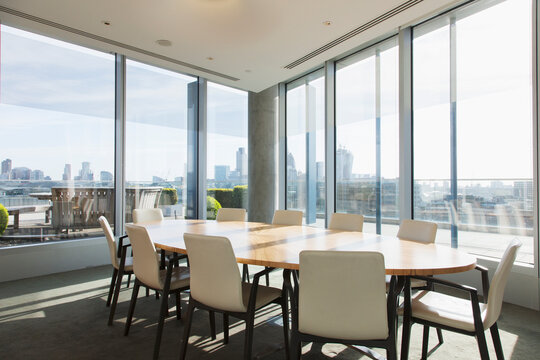 Round table in sunny highrise business conference room