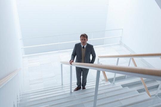 Portrait confident businessman on modern stairs