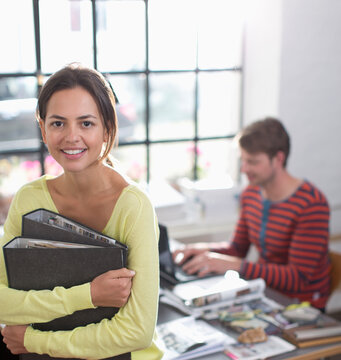 Portrait smiling young creative businesswoman in office