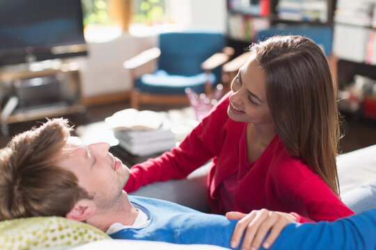 Happy couple talking on sofa