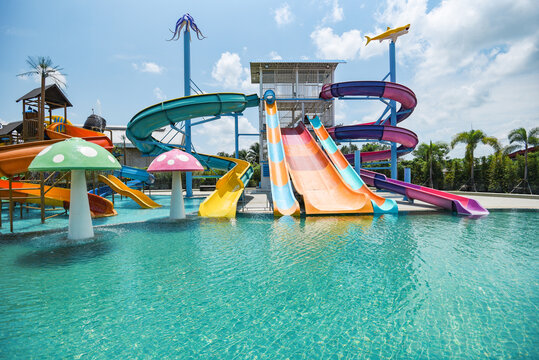water park slide with swimming pool at amusement park colored plastic water slides with pool in outdoor aqua park