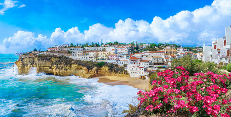 Wall Mural - Carvoeiro town with colorful houses and yellow sand beach in Algarve, Portugal