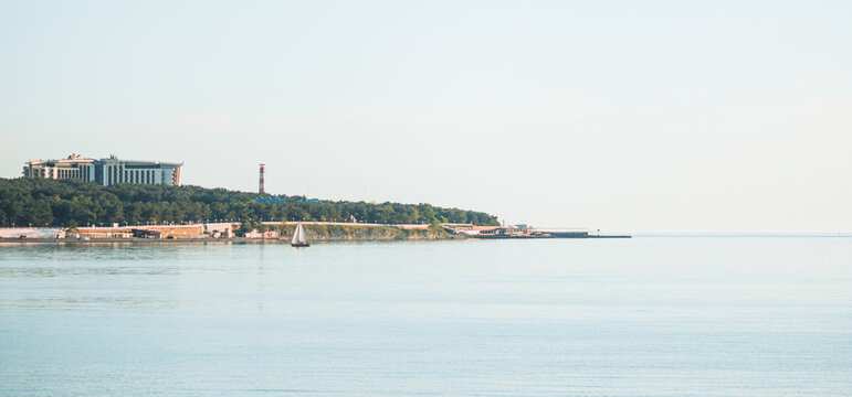 Gelendzhik, Russia. Thick Cape and lighthouse of city resort in Black sea bay in summer season.