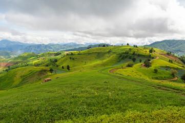 Summer mountains green grass landscape, Doi mae Tho, Chiang Mai, Thailand