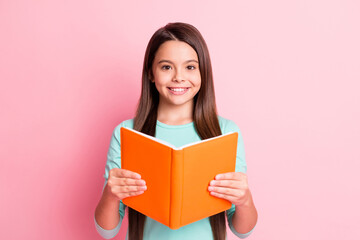 Photo sur Plexiglas Dinosaurs Photo of pretty sweet small hispanic lady long hairdo arms hold orange diary beaming shiny smile prepare read aloud wear turquoise teal sweatshirt isolated pink color background